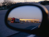 A Rearview Mirror Reflects a Busy Tollgate on the New Jersey Turnpike