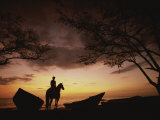Horseback Rider Silhouetted on a Beach at Twilight  Costa Rica
