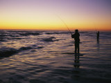 People are Surf Fishing for Red Drum on the Outer Banks of North Carolina