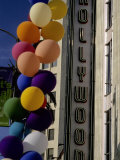 Multi-Colored Balloons and a Neon Sign Welcome Visitors to Hollywood