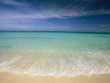 Eau bleue translucide et nuages effilochés sur la plage de Cancun Papier Photo par Michael Melford
