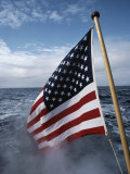 An American Flag Flutters from the Back of a Boat in Neah Bay