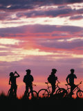 Silhouetted Bikers against a Twilight Sky