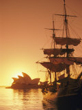 Sydney Opera House and the Hms Bounty  a Replica of the Famous Ship  Silhouetted by the Setting Sun