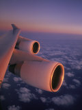 A Close View of the Wing and Jet Engines of a Plane in Flight