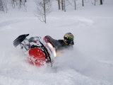 A Snowmobiler Spins Through Deep Powder