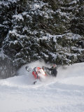 A Snowmobiler Spins Through Deep Powder