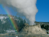 A Rainbow Forms During an Eruption of Castle Geyser