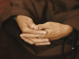Close View of a Monks Hands Crossed in Prayer