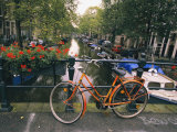 The Keizersgracht Canal  with Potted Flowers and a Bicycle in the Foreground