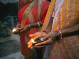 Women Hold Votive Lamps in Their Hands