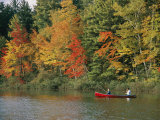 Father and Son Fish from a Canoe Amid the Autumn Foliage