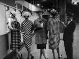 5 Models Wearing Fashionable Dress Suits at a Race Track Betting Window  at Roosevelt Raceway