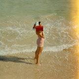 Female Tourist Enjoying Surf on a Florida Beach