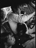 Senator Robert Kennedy Driving Car with Pet Springer Spaniel over His Lap and Son Max Beside Him