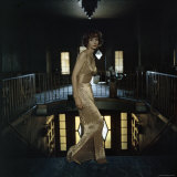 Model Wearing Gold Beaded Sheath Gown by Designer Helen Rose