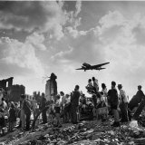 US C-47 Cargo Plane Flying over Ruins  Approaching Tempelhof Airport with Food and Supplies