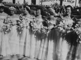 Six Bridesmaids Pose Together in White Organdy Gowns For Elizabeth Taylor and Nicky Hilton Wedding