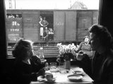 "Wife and Daughter of US Soldier in First Class Dining Car Looking at German ""Expelles"" in Boxcars"