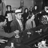 The Salvation Army Band Playing Musical Instruments and Singing in a Bar