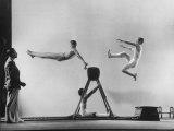 Erik Flensted Jensen  Coach of Danish Gymnastic Team  Watching as Three Men Perform