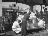 Muller Brothers Service Station's Attendants Pumping Gas and Inflating Tires on a Fancy Convertible