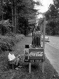 Boy Selling Coca-Cola from Roadside Stand