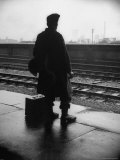 Army Sergeant Visiting Home on Leave Waiting at the Railway Station