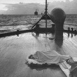 US Sailors Sleeping on Deck of Ship