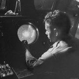Man Looking at Radar Scope to Gather Weather Information