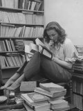French Actress Barbara Laage, Alone in Her Apartment Reading Papier Photo par Nina Leen