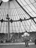 Crowds Watching a Circus Performer