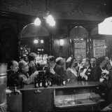 Patrons Drinking and Chatting at the Bar of a Music Hall