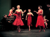 "Four Models in Red Dresses Dancing Charleston For Article Featuring ""The Little Red Dress"""