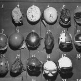 Jet Pilot Helmets and Goggles Hanging on Hooks