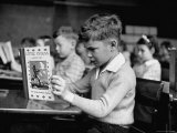 Child Reading a Book in School