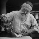 Factory Union Member David Zwiren Using Steam Iron