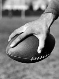 Holding the Football is Player Paul Dekker of Michigan State