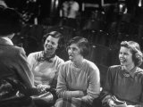 High School Student Dorothy Parker Smiling and Sitting with Others in Play