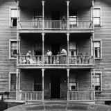 Family on Balcony of Apartment Building Papier Photo par Gordon Parks