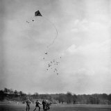 Children Playing with Kite That Releases Toys While in the Air