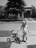 Child Playing with Tricycle