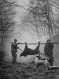 Jim Atchley and Dr Ray Atchley Carrying Boar That They Killed