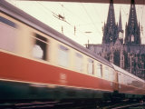 Eurailpass in Europe: Germany's Parsifal Express Speeding Past Cologne Cathedral