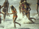 Bikini Clad Teens Frolicking in Surf at Beach