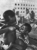 Biafran Child Feeding Another Child