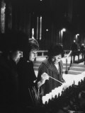Girls Lighting Votive Candles at a Shrine in St Patrick's Cathedral  in Prayer For John F Kennedy