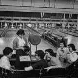 Teenagers Spending Allowance on Bowling