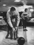 Dad Showing 3 Year Old Daughter the Basics of Bowling