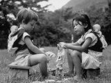 American Child Playing with Chinese Friend  Washing Doll Clothes